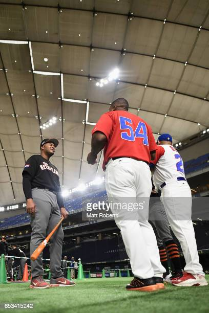 Outfielder Kalian Sams of the Netherlands talks with Outfielder Alfredo Despaigne and Designated hitter Frederich Cepeda of Cuba prior to the World...