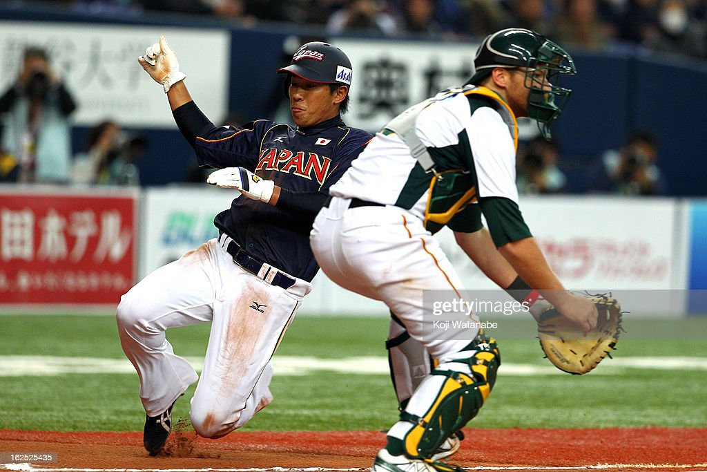 Outfielder Katsuya Kakunaka #61 of Japan slides in to home plate in the top half of the sixth inning during the international friendly game between Australia and Japan at Kyocera Dome Osaka on February 24, 2013 in Osaka, Japan.