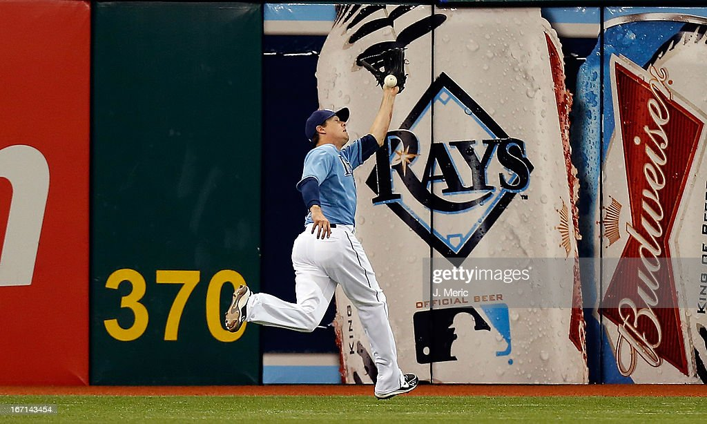 Outfielder Kelly Johnson #2 of the Tampa Bay Rays cannot make the catch on this fly ball against the Oakland Athletics during the game at Tropicana Field on April 21, 2013 in St. Petersburg, Florida.