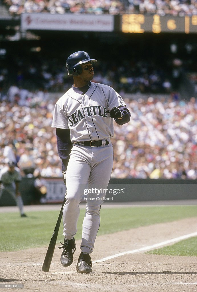 be5b14cc00 Outfielder Ken Griffey Jr. #24 of the Seattle Mariners swings and ...