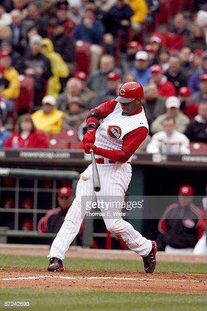 Outfielder Ken Griffey Jr. #3 of the Cincinnati Reds pop flys a ball against the Chicago Cubs on Opening Day at Great American Ball Park on April 3,...