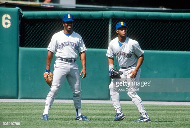 Outfielder Ken Griffey Jr and his father Ken Griffey Sr of the Seattle Mariners stands together in the outfield during batting practice prior to the...