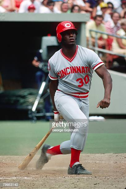 Outfielder Ken Griffey Sr #30 of the Cincinnati Reds bats against the Pittsburgh Pirates at Three Rivers Stadium in July 1976 in Pittsburgh...