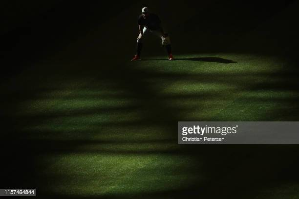 Outfielder Kevin Pillar of the San Francisco Giants warms up before the MLB game against the Arizona Diamondbacks at Chase Field on June 21 2019 in...