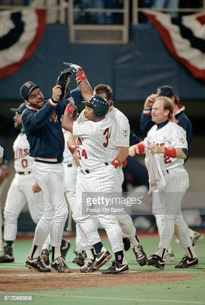 Outfielder Kirby Puckett and teammates of the Minnesota Twins celebrates after Puckett hit a walkoff home run in the bottom of the 11th inning...