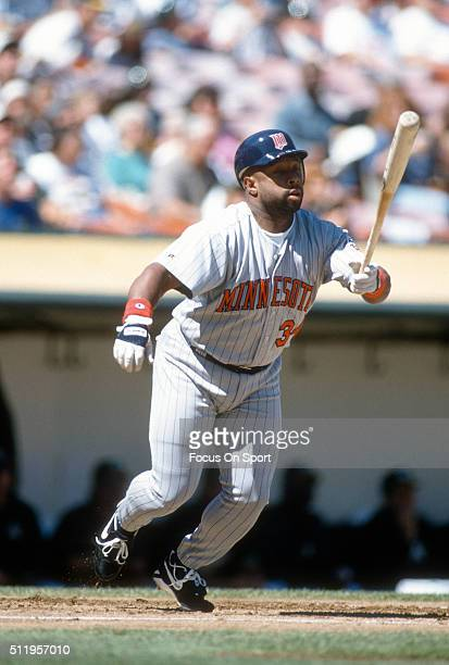 Outfielder Kirby Puckett of the Minnesota Twins bats against the Oakland Athletics during a Major League Baseball game circa 1995 at the...