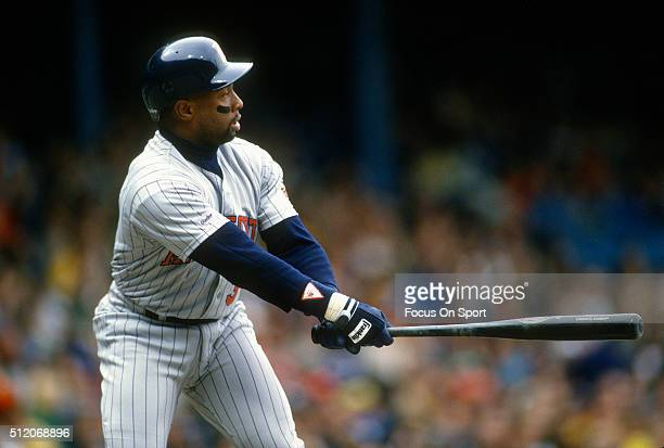 Outfielder Kirby Puckett of the Minnesota Twins bats against the Detroit Tigers during a Major League Baseball game circa 1987 at Tiger Stadium in...
