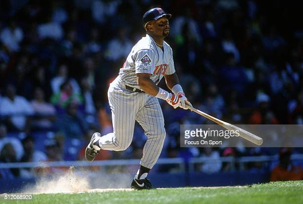 Outfielder Kirby Puckett of the Minnesota Twins bats against the Detroit Tigers during a Major League Baseball game circa 1991 at Tiger Stadium in...