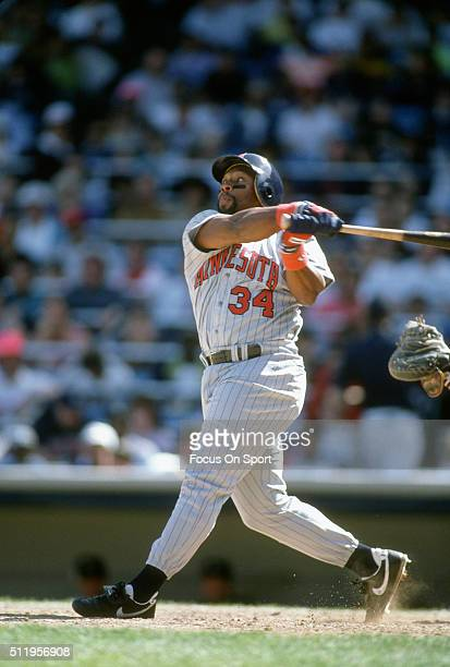 Outfielder Kirby Puckett of the Minnesota Twins bats against the New York Yankees during a Major League Baseball game circa 1991 at Yankee Stadium in...
