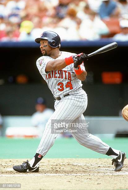 Outfielder Kirby Puckett of the Minnesota Twins bats against the Kansas City Royals during a Major League Baseball game circa 1987 at Royals Stadium...