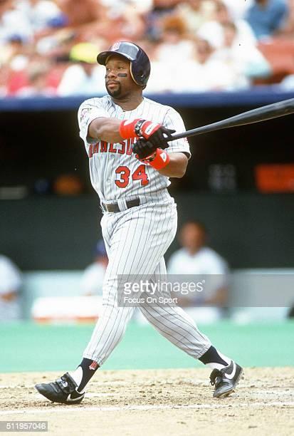Outfielder Kirby Puckett of the Minnesota Twins bats against the Kansas City Royals during a Major League Baseball game circa 1987 at Royals Stadium...