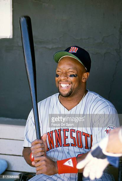 Outfielder Kirby Puckett of the Minnesota Twins looks on from the dugout during a Major League Baseball game circa 1989 Puckett played for the Twins...