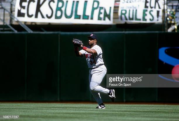 Outfielder Kirby Puckett of the Minnesota Twins makes the catch in the outfield against the Oakland Athletics circa 1995 during a MLB baseball game...