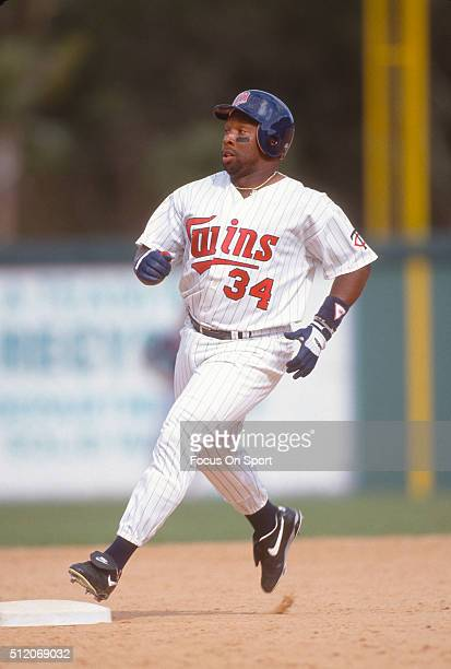 Outfielder Kirby Puckett of the Minnesota Twins runs the bases during Major League Baseball spring training game circa 1992 a Hammond Stadium in Fort...