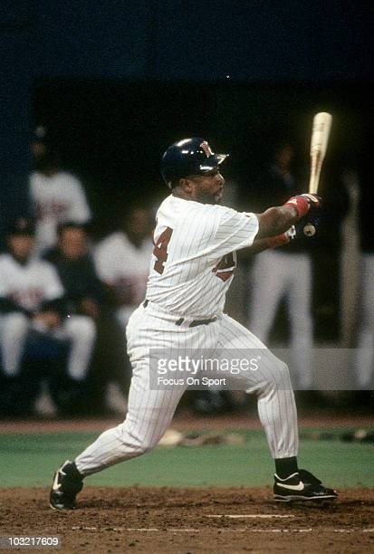 Outfielder Kirby Puckett of the Minnesota Twins swings and watches the flight of his ball against the Oakland Athletics circa 1993 during a MLB...