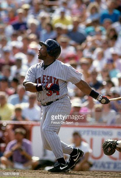 Outfielder Kirby Puckett of the Minnesota Twins swings and watches the flight of his ball circa 1993 during a spring training MLB baseball game...