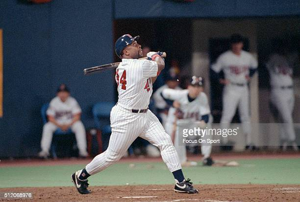 Outfielder Kirby Puckett of the Minnesota Twins swings and watches the flight of his ball against the Atlanta Braves in Game 6 of the World Series...