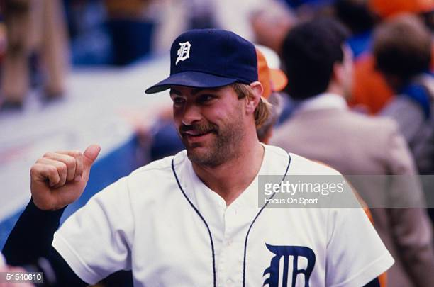 Outfielder Kirk Gibson of the Detroit Tigers gestures to someone in the stands during the World Series against the San Diego Padres at Tiger Stadium...