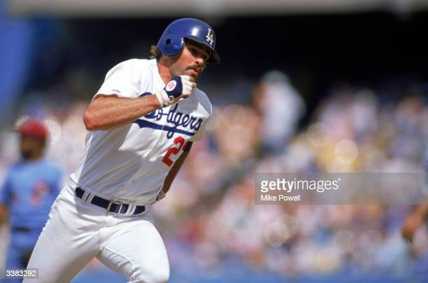Outfielder Kirk Gibson of the Los Angeles Dodgers rounds the bases during a 1988 season game against the Philadelphia Phillies at Dodger Stadium in...