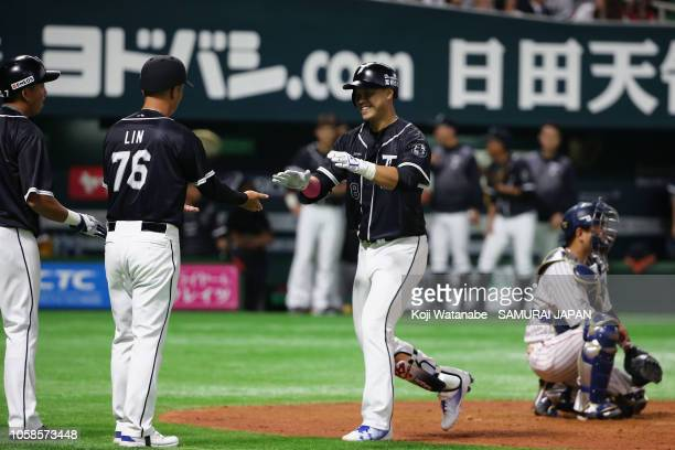 Outfielder Lan YinLun of Chinese Taipei celebrates hitting a threerun homer in the top of 5th inning during the baseball friendly between Japan and...