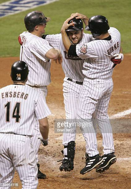 Outfielder Lance Berkman of the Houston Astros celebrates with teammates after hitting a 3 run home run against the St Louis Cardinals during the...