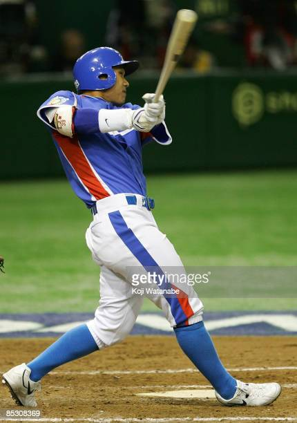 Outfielder Lee Jong Wook of South Korea hits a single in the top of eighth inning during the World Baseball Classic Pool A Tokyo Round match between...