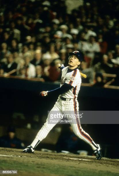 Outfielder Lenny Dykstra of the New York Mets swings and watches the flight of his ball against the Boston Red Sox in a World Series gams October...