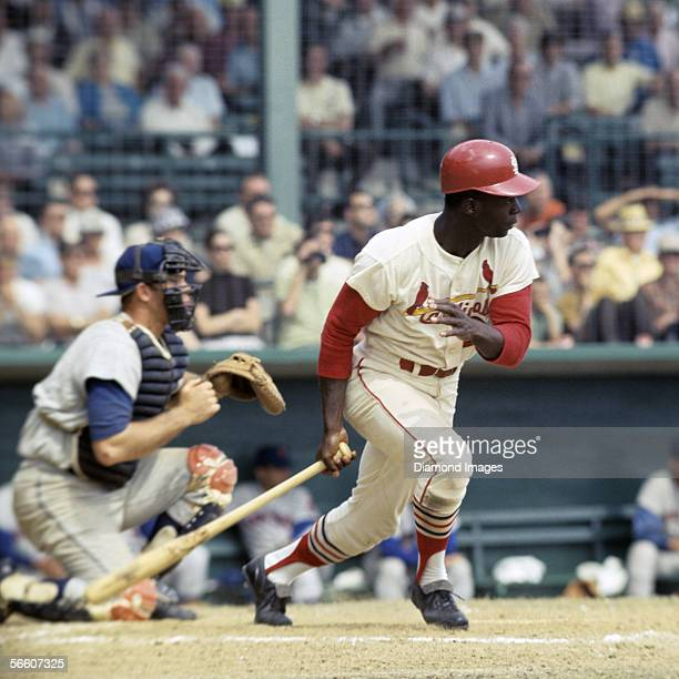 Outfielder Lou Brock of the St Louis Cardinals at bat during Spring Training game against the New York Mets in March 1968 in St Petersburg Florida