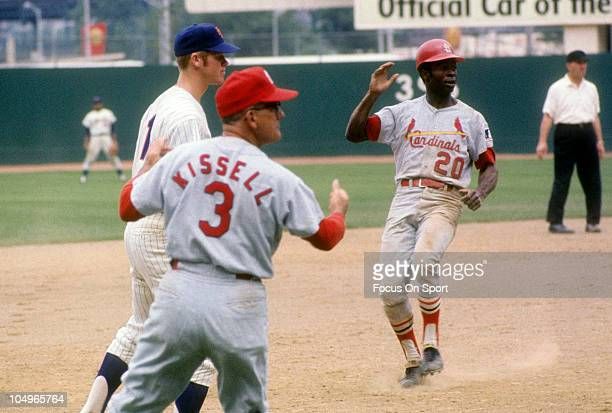 Outfielder Lou Brock of the St Louis Cardinals cruises into third base against the New York Mets during a Major League Baseball game circa 1969 at...