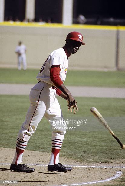 Outfielder Lou Brock of the St Louis Cardinals draws a walk during a MLB baseball game circa late 1960s at Busch Stadium in St Louis Missouri Brock...