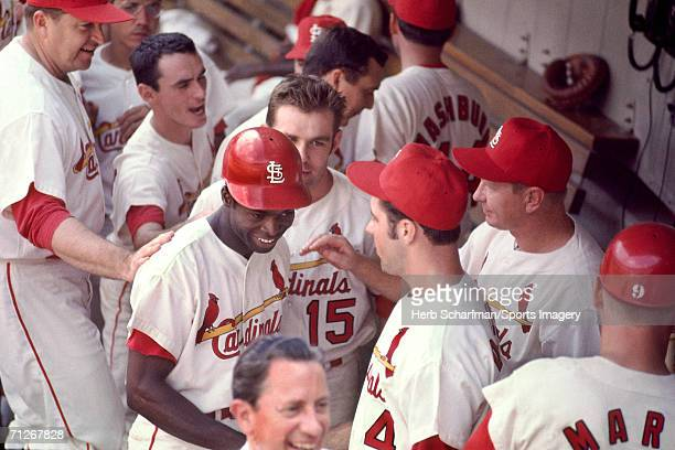 Outfielder Lou Brock of the St Louis Cardinals is congratulated by teammates during a 1968 World Series game against the Detroit Tigers at Busch...