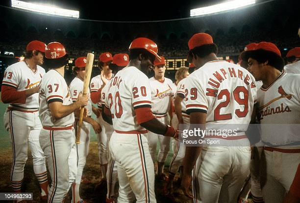 Outfielder Lou Brock of the St Louis Cardinals is greated by teammates after getting career hit number 3000 against the Chicago Cubs August 13 1979...