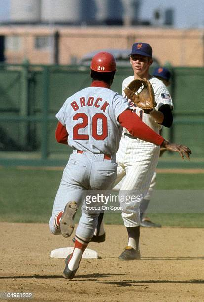 Outfielder Lou Brock of the St Louis Cardinals races towards second base against the New York Mets during a Major League Baseball game circa 1969 at...