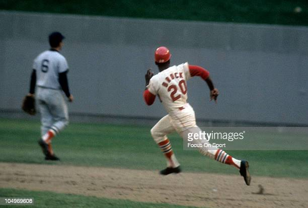 Outfielder Lou Brock of the St Louis Cardinals runs around the bases against the Boston Red Sox in the World Series October 1967 at Busch Stadium in...
