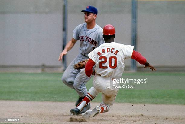 Outfielder Lou Brock of the St Louis Cardinals slides into second base against the New York Mets during a Major League Baseball game circa 1967 at...