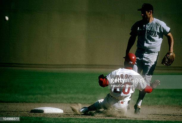 Outfielder Lou Brock of the St Louis Cardinals slides into second base against the Detroit Tigers during the World Series October 1968 at Busch...