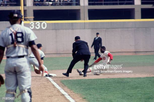 Outfielder Lou Brock of the St Louis Cardinals slides into third base during a 1967 World Series game against the Boston Red Sox in October 7 1967 at...