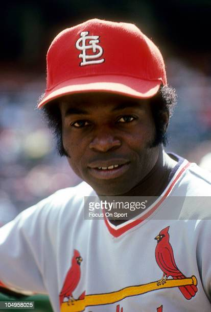 Outfielder Lou Brock of the St Louis Cardinals smiling in this portrait during batting practice prior to the start of a Major League Baseball game...