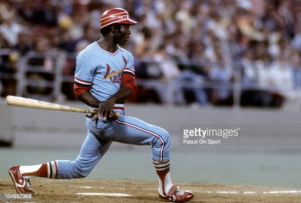 Outfielder Lou Brock of the St Louis Cardinals swings and watches the flight of his ball during a Major League Baseball game circa 1978 Brock played...