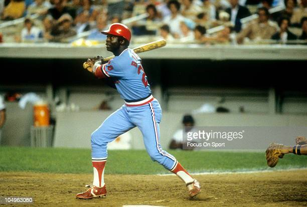 Outfielder Lou Brock of the St Louis Cardinals swings and watches the flight of his ball against the New York Mets during a Major League Baseball...