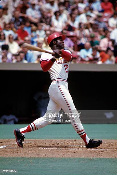 Outfielder Lou Brock of the St Louis Cardinals swings at a pitch during a game in June 1971 at Busch Stadium in St Louis Missouri