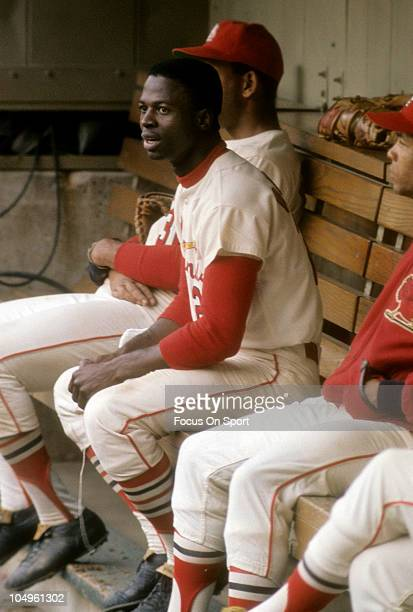 Outfielder Lou Brock of the St Louis Cardinals watches the action from the bench during a Major League Baseball game circa 1968 at Busch Stadium in...