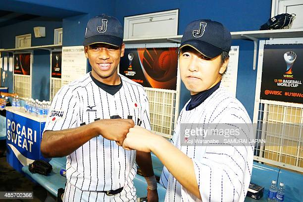 Outfielder Louis Okoye and Starting pitcher Sena Satoh pose for a photograph after winning in the first round game between Japan and USA during the...