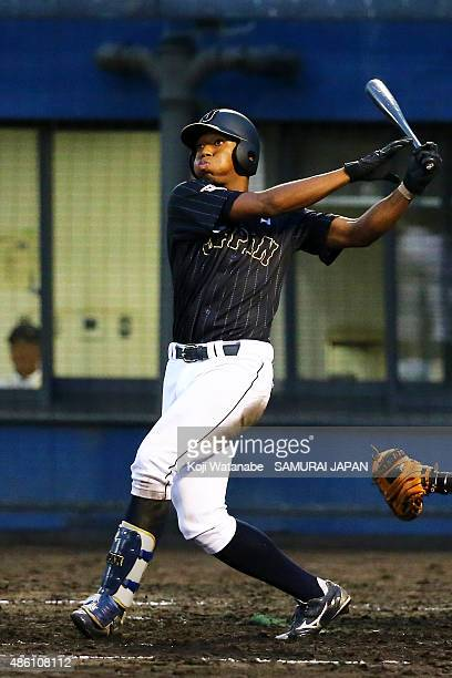 Outfielder Louis Okoye bats in the first round game between Czech Republic v Japan during the 2015 WBSC U-18 Baseball World Cup at the Maishima...