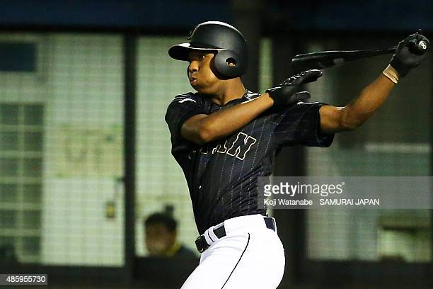 Outfielder Louis Okoye bats in the top half of the fifth inning in the first round game between Australia v Japan during the 2015 WBSC U-18 Baseball...