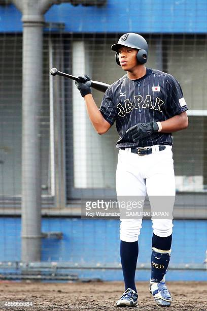 Outfielder Louis Okoye bats in the top half of the first inning in the first round game between Australia v Japan during the 2015 WBSC U-18 Baseball...