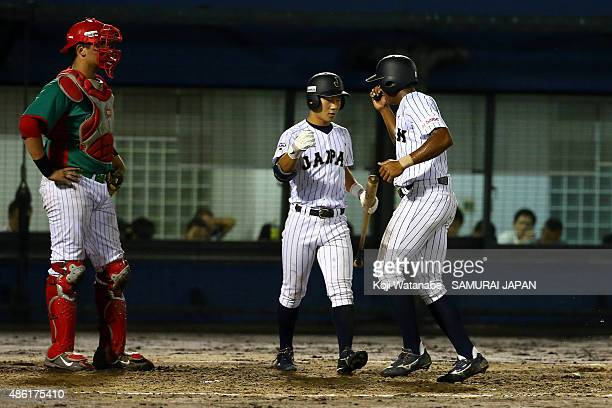 Outfielder Louis Okoye celerates after scoring in the bottom half of the second inning in the first round game between Japan v Mexico during the 2015...