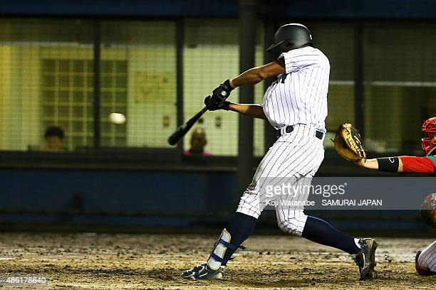 Outfielder Louis Okoye hits a RBI double in the bottom half of the fourth inning in the first round game between Japan v Mexico during the 2015 WBSC...