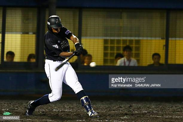 Outfielder Louis Okoye hits a RBI single in the top half of the nineth inning in the first round game between Australia v Japan during the 2015 WBSC...