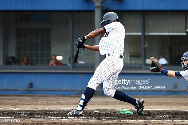 Outfielder Louis Okoye of Japan hits a singel in the bottom half of the first inning in the first round game between Japan and USA during the 2015...